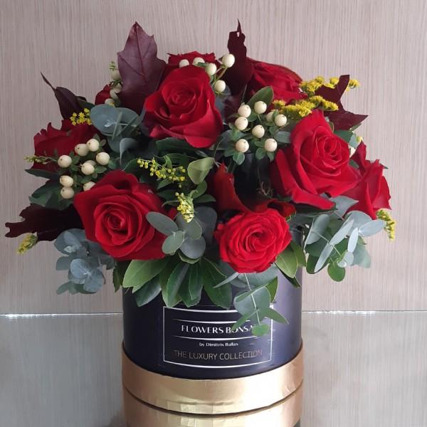 Στρογγυλό κουτί με φθινοπωρινά άνθη